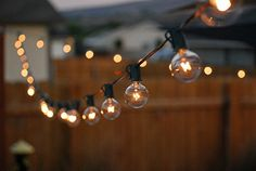 Amazon.com: G40 Globe String Lights Set with 25 Clear G40 Bulbs Included, End-to-end - UL Listed Indoor & Outdoor Lights Settings With Warm Romantic Ambience - Patio Lights & Patio String Lights - Perfect for Backyards, Gazebos, Patios, Gardens, Pergolas, Decks, City Rooftops, Weddings, Bbq, Dinner Parties, Holidays - Commercial Quality String Light Fixture for Indoor / Outdoor Use - Updated Incandescent Energy-efficient Bulbs - Black Wire - 100% Satisfaction Guarantee: Home Improvement