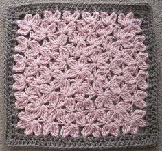 """Crocheted in the round like a granny square, this textural beauty will remind you of an endless field of flowers. Worked primarily in treble crochet, three rows of border will bring it up to 12""""."""