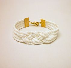 Matte white knotted nautical rope bracelet with gold anchor charm. $13.00, via Etsy.