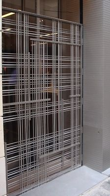 outside balustrades, rollaway gate in stainless steel, customized project Shop, Contract, Boutique Zegna Paris balustrades Metal Gates, Metal Screen, Metal Roof, Gate Design, Screen Design, Door Design, Bar Deco, Partition Screen, Glass Partition