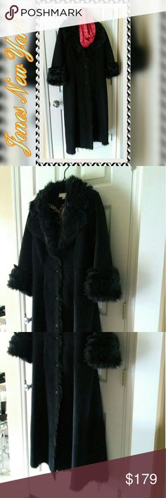 EUC Jones New York Long Coat Gorgeous gently used Jones New York long faux fur lined cozy dress coat. Size large. Very warm and plush. No issues what so ever and clean smoke-free. Split sleeves can be turned in or out at wrist. Tapers at waist for a slimming look & flares out for a sleek dressy look. I will be happy to answer any questions or post additional pics by request. Total length is 52 inches. True to U.S. size large. Excellent condition. Jones New York Jackets & Coats