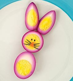 This is just hard boiled egg soaked in beetroot juice. Bright little bunnies sitting on plates! Could you imagine how cute this would look on your kid's plate!! No artificial color here.
