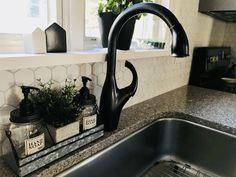 Quartz countertops / hexagon kitchen backsplash / light gray grout / oil rubbed bronze hardware