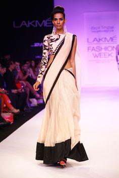Printed One Sleeve Blouse worn with Blush Mul Kalidaar Lehenga Sari. Shop The Look at http://www.payalsinghal.com/off-the-runway/mashal-lehenga-saree