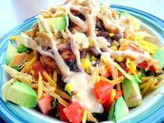 BBQ Chicken Salad  Chopped Romaine Lettuce  1/2 cup Black Beans  1/2 cup canned corn   1/2 cup chopped tomato  1/2 cup shredded cheddar cheese  1/4 cup crumbled bacon  1/4 cup French Fried Onions (or bake a tortilla and cut into strips)  1/2 cup fresh California Avocados, diced    1 grilled, BBQ chicken breast, diced    Dressing:  1/4 cup ranch  2 tbsp. barbecue sauce