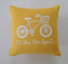 Pillow Cover Cushion Cover Bicycle - Eat. Sleep. Bike. Repeat. on Mustard Yellow Linen  - 12 x 12 inches. $22.00, via Etsy.