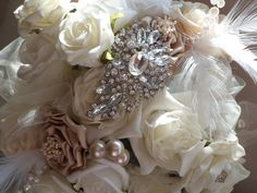 Vintage Downtown Abbey...adding a beautiful vintage brooch to your birdcage veil or a brooch bouquet is the perfect touch for this theme.