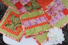 Purple, Orange, green table runner and matching hotpads.