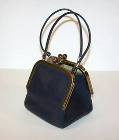 Bonnie Cashin was one of the most innovative designers of her time and her influence continues to be seen in fashionable American sportswear. This adorable navy blue leather handbag was designed for Coach in the It features two kiss lock Handbags On Sale, Luxury Handbags, Fashion Handbags, Purses And Handbags, Fashion Bags, Popular Handbags, Ladies Handbags, Spring Handbags, Cheap Handbags