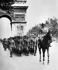 German troops parade down the Champs-Elysees in Paris Thousands of French Nazi collaborators to be exposed as official reports are published online for the first time Germany Ww2, Iconic Photos, German Army, Historical Pictures, War Machine, Military History, World History, World War Two, Wwii