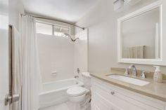 Transitional Full Bathroom with Limestone, limestone tile floors, Limestone counters, Undermount Sink, Flat panel cabinets
