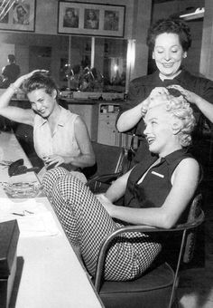 Marilyn Monroe and Jean Peters at Fox Studios. Photo by Philippe Halsman, 1952.