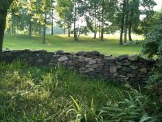I want this natural stone fence with a black galvanized steel fence on top of it.