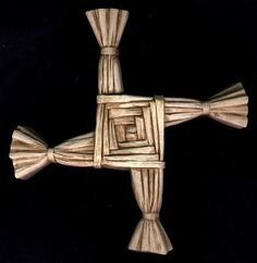 """St. Brigid's Cross  Legend says this cross was woven by the patron saint of Ireland to explain the Passion.  Its heritage extends to the Neolithic Age when it symbolized the four seasons. It is now hung over Irish doorways to protect home and hearth.  It is also related to the symbol of the """"turning wheel"""" which symbolized the movement of the sun and is a design seen on Celtic crosses."""