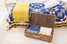 Take advantage of dead space beneath the bed to store off-season linens or extra blankets. A bin fitted with casters and a lid is a snap to access, and a cloth lining is soft on fabrics. From @thecompanystore
