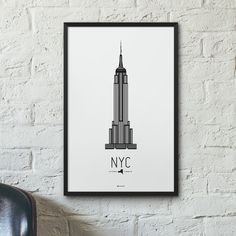 The New York City Icon poster features the Empire State Building, a 102-story Art Deco-style skyscraper located in the Manhattan borough of New York City, New York. It is the first building to have mo