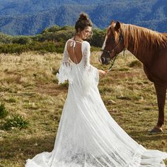Double tap if you love this @grace_loves_lace bohemian wedding gown!  #graceloveslace #bohoweddingdress #bohemianweddingdress #weddingdress #weddinggown #bridalgown #bridal #bridalcouture #weddingfashion #fashion #laceweddingdress #longsleeveweddingdress #xaazastyle
