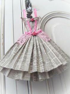 News paper dress on a hanger