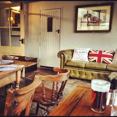 Having a pint in a traditional Dorset pub. Love the vintage styling and the union jack cushion on the old leather sofa! Photo from the Instacanvas gallery for kitzieg.