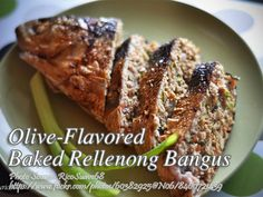 A baked stuffed milkfish or rellenong bangus flavored with stuffed olives and olive oil. #OliveFlavored #RellenongBangus #BakedBangus Stuffed Olives, Stuffed Mushrooms, Stuffed Peppers, Roasted Chicken, Baked Chicken, Filipino Recipes, Filipino Food, Calamansi Juice, Pancit