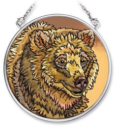Amia Hand Painted Glass Suncatcher with Grizzly Bear Design, 3-1/2-Inch Circle by Amia. $10.00. Includes chain. Comes boxed, makes for a great gift. Handpainted glass. Amia glass is a top selling line of handpainted glass decor. Known for tying in rich colors and excellent designs, Amia has a full line of handpainted glass pieces to satisfy your decor needs. Items in the line range from suncatchers, window decor panels, vases, votives and much more.