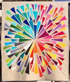 Starburst style quilt, improv triangles, rainbow