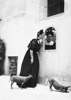 Frida Kahlo and her Itzcuintli dogs, c. 1944 Photograph by Lola Alvarez Bravo.