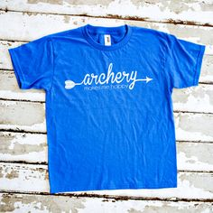 Archery makes me happy! This royal blue tee is the perfect shirt for young…