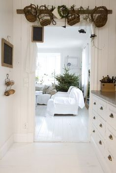 simple...charming...pot and basket rack above the door