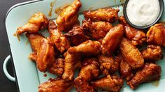 Coca Cola Wings - These positively addictive chicken wings feature a spicy-sweet sauce with a surprising secret ingredient: cola. Coca Cola Chicken Wings, Sweet Sauce, Chicken Wing Recipes, Game Day Food, Appetizers For Party, Carne, Mozzarella, Cooking Recipes, Cooking Videos