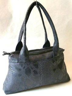 Voici le sac que j'ai cousu avant les fêtes de fin d'année : il s'agit du sac City Zip-Zip, le nouveau patron de Sacôtin !