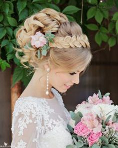 Isn't this style stunning? We love the romantic curls and the braided accent! Looking for wedding hairstyles? We've put together a list of 16 romantic looks for spring and summer weddings!