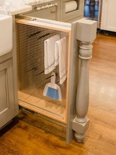 Also hidden in the kitchen island are two pull-out columns. They look purely…