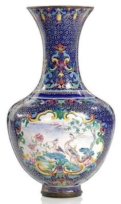 A Canton enamel on copper phoenix wall vase, China, 18th century.