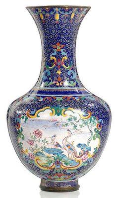A Canton enamel on copper phoenix wall vase, China, 18th century.