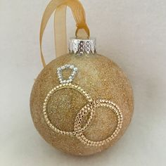 Glittered wedding ring 💍 glass ornament. A great gift 🎁 for that special couple.