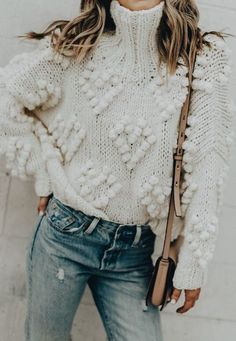 Fall sweater with high neck and denim.