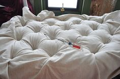 "Diamond tufting tute - we used 3/4"" plywood, 2"" green foam, a foam mattress pad (twin size for a queen size headboard) from Target, a twin size roll of batting. We drilled 10 holes, I had the buttons covered by an upholsterer, and he gave us tufting twine (sturdy). My fabric was 54"" wide. Gorgeous results! Thanks to Emily!."