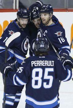 Winnipeg Jets' Drew Stafford (12), Bryan Little (18), Andrew Ladd (16) and Mathieu Perreault (85) celebrate Stafford's g...