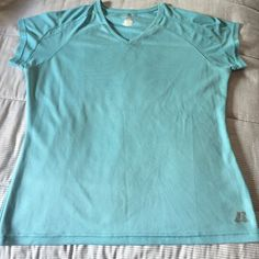 Russell athletic top Light turquoise athletic top. V neck. Short sleeve. Like new. Russell Athletic Tops