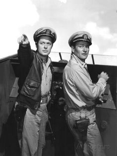 "Robert Montgomery, John Wayne in ""They Were Expendable"" (1945). Country: United States. Director: John Ford."
