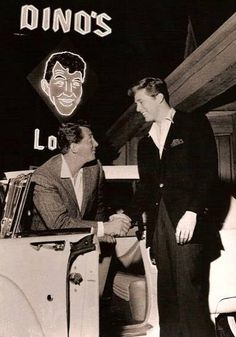 """Edd Byrnes (""""77 Sunset Strip"""" and """"Grease"""") welcomes Dean Martin as he arrives at Dino's Lodge in his 1959 Ford Thunderbird Convertible. Dinos Lodge was next door to the 'fake' 77 Sunset Strip location used for that TV show.  Dino's pull in driveway entrance was what you always saw when Kookie (Edd Byrnes) took care of cars for the Lodge and 'helped' out on the various PI cases for Efrem Zimbalist, Jr."""