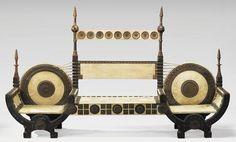 CARLO BUGATTI (1856-1940), Canapé, en bois sculpté, tourné, incrusté de cuivre et d'étain, formé de deux sièges curule et d'une banquette centrale. Parchemin et cordage d'époque (tâches et accidents au parchemin, manque deux colonnettes)  |  Sotheby's Paris, May 26, 2005