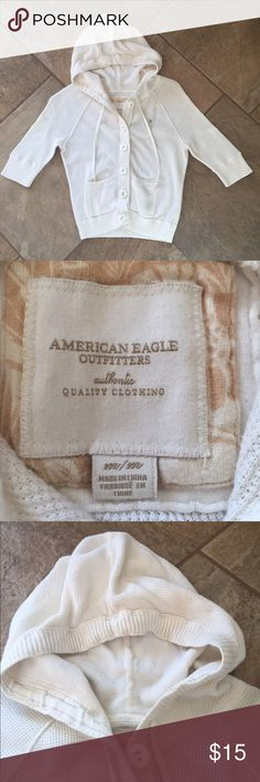 AMERICAN EAGLE Cardigan Cropped waffle knit hooded cardigan, sleeves go to right above the elbow, button down closure, light weight, LIKE-NEW condition. This would better fit a size SMALL. American Eagle Outfitters Sweaters Cardigans
