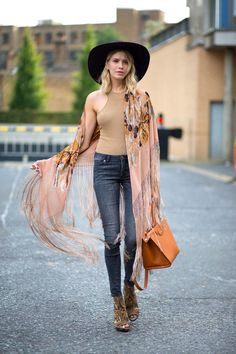 Elena Perminova is perfection in this fringed kimono at LFW SS 16.  Perfect London street style vibes!