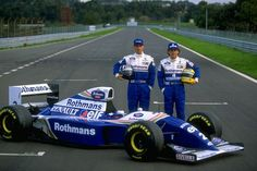 Williams Renault team drivers Damon Hill of Great Britain and Ayrton Senna of Brazil with a Williams Renault car - January 1994