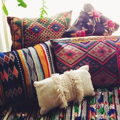 Bohemian cushions - loving the eclectic mix of colours, prints & textures.