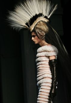 A model wears an outfit during the presentation of Franck Sorbier's Spring/Summer 2011 Paris High Fashion January 26, 2011