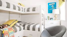 Custom bunk beds in this Southern California kids' room are topped with comforters in an eye-catching gray stripe. A fun poster and yellow accemts add more visual interest.