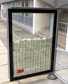 Ad for 3M Security Glass. The person who could break the glass, got to keep all the money inside